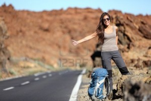 10473236-travel-woman-hitchhiking-beautiful-young-female-hitchhiker-by-the-road-during-vacation-trip-on-volca